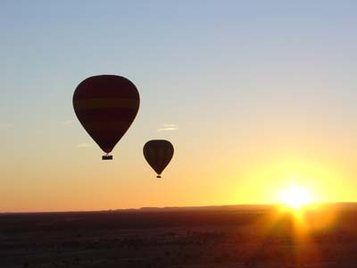 sunrise behind balloon