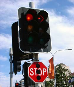 Traffic signal with stop sign beneath it